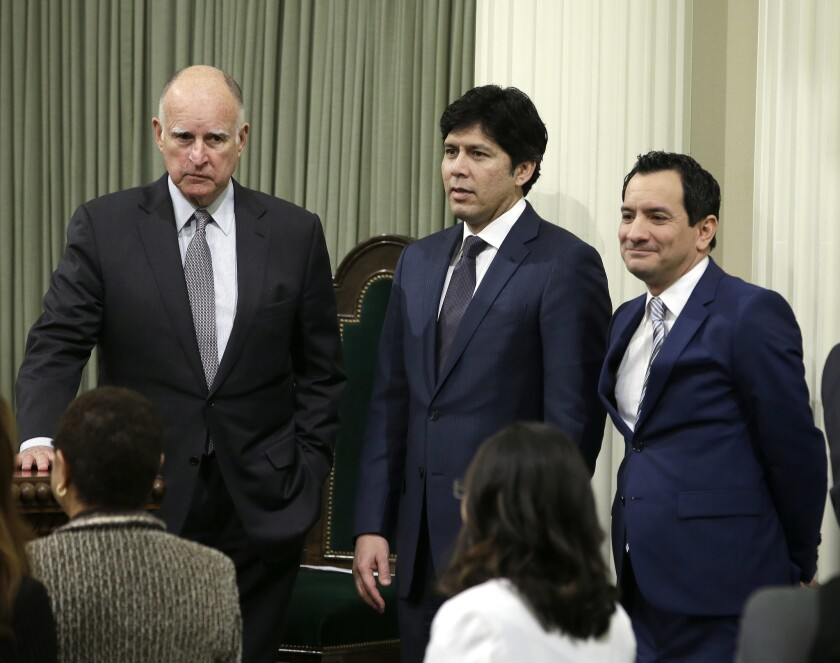 Gov. Jerry Brown, from left, Senate leader Kevin de León and Assembly Speaker Anthony Rendon, pictured here in the Capitol in March, reached a deal on state spending several days before this year's deadline.