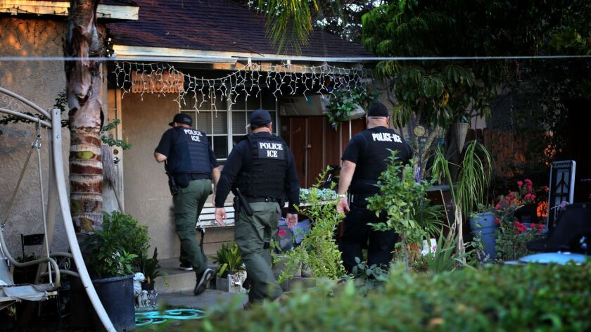 ICE agents during a 2015 immigration sweep in Riverside. Immigrant advocates say the Trump administration's announcement of sweeps starting Sunday are spreading fear in immigrant communities.