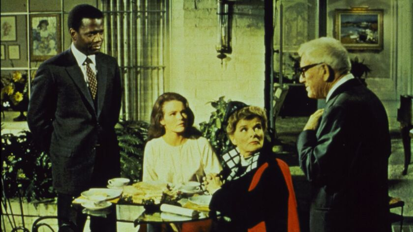 "Sidney Poitier, Katharine Houghton, Katharine Hepburn and Spencer Tracy in the 1967 Academy Award-nominated ""Guess Who's Coming to Dinner."""