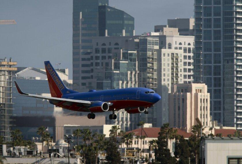 A plane landing at San Diego International Airport.