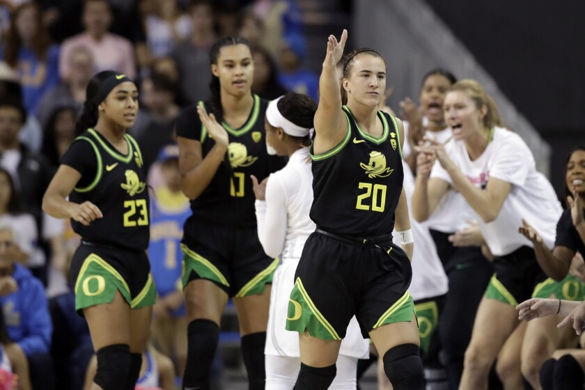 Oregon guard Sabrina Ionescu (20) signals after a call in the team's favor during the first half of an NCAA college basketball game against UCLA on Friday, Feb. 14, 2020, in Los Angeles. (AP Photo/Marcio Jose Sanchez)