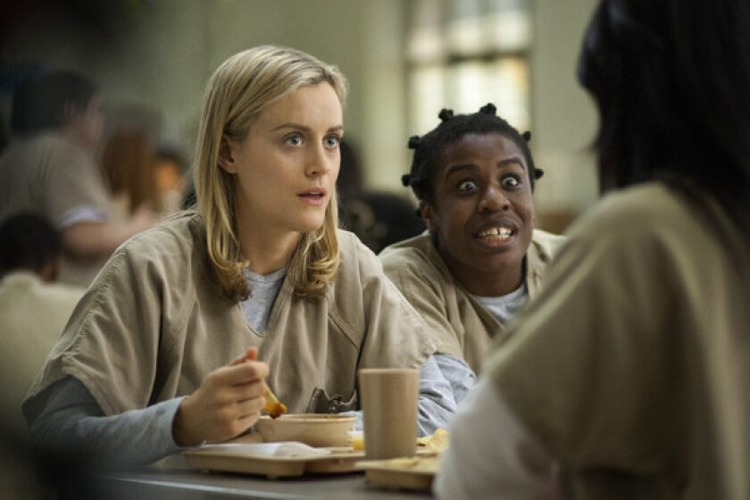 """Taylor Schilling, left, and Uzo Aduba star in the Netflix series """"Orange Is the New Black."""""""