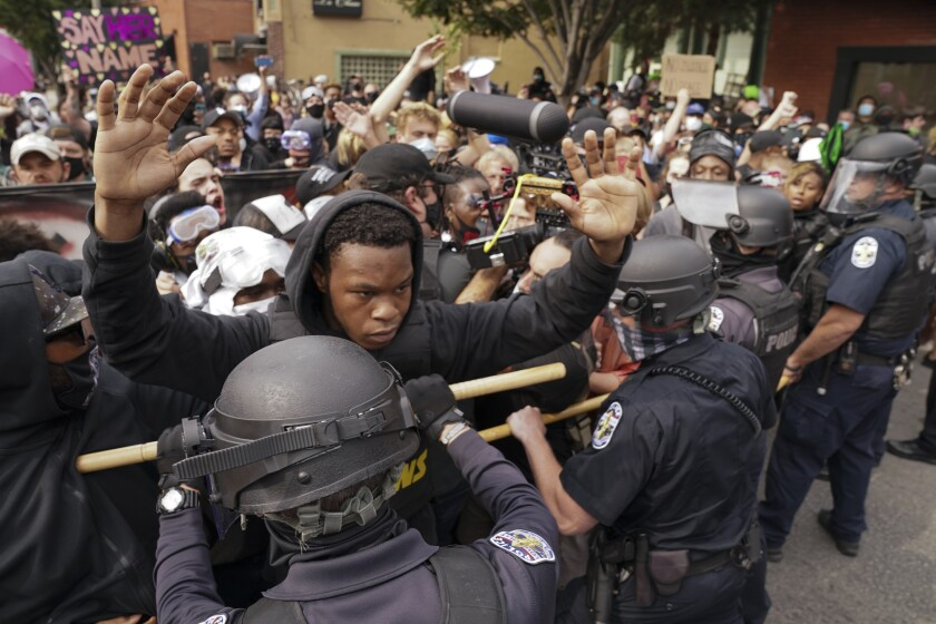 Police and protesters converge during a demonstration in Louisville, Ky.