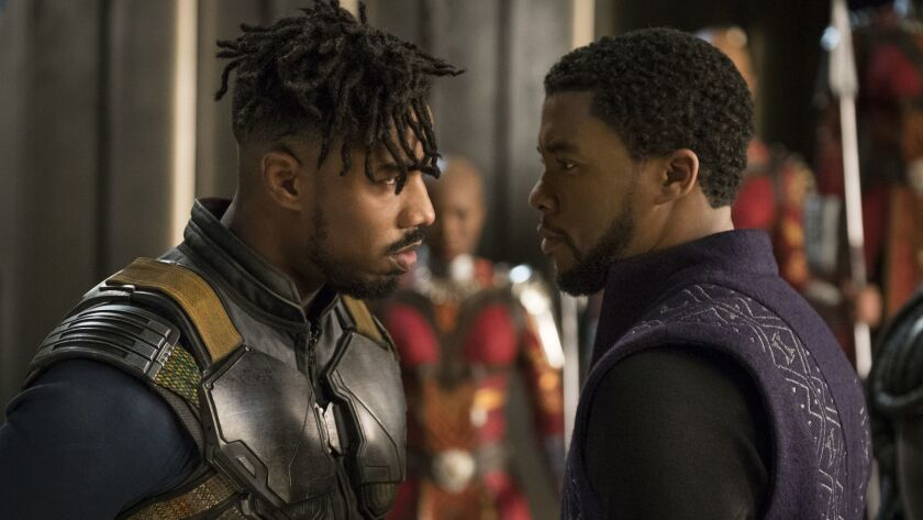 "Michael B. Jordan, left, and Chadwick Boseman in a scene from Marvel Studios' ""Black Panther."""