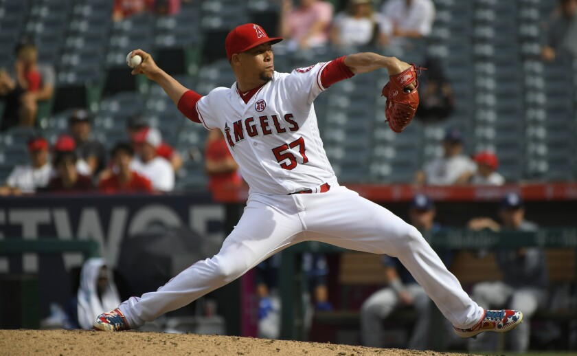 Angels pitcher Hansel Robles delivers during a 6-4 victory over the Tampa Bay Rays on Sunday.