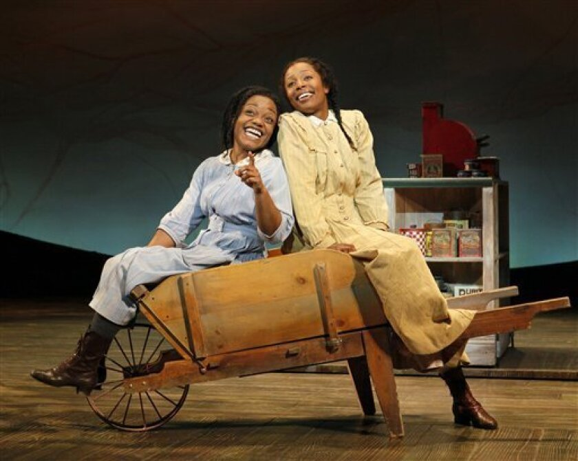 """This undated picture provided by It Is Done Communications Public Relations shows Kenita R. Miller as Celie and LaToya London as Nettie in The Color Purple in New York. Broadway shows are finally back in New Orleans for the first time since Hurricane Katrina four years ago, and at least one - """"The"""
