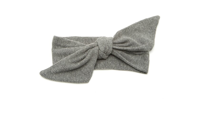 Donni Charm grey thermal poppy headband. At President Obama's first inauguration Aretha Franklin