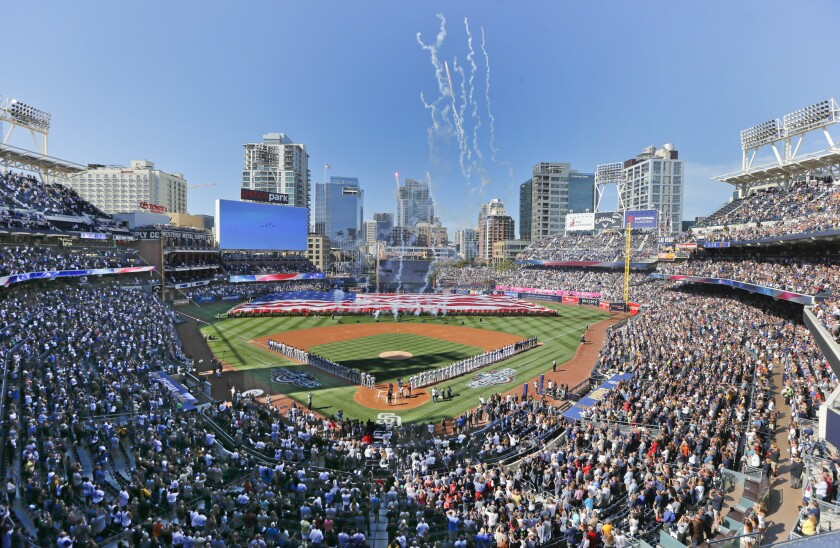 Opening day ceremonies are performed at Petco Park before a baseball game between the Los Angeles Do