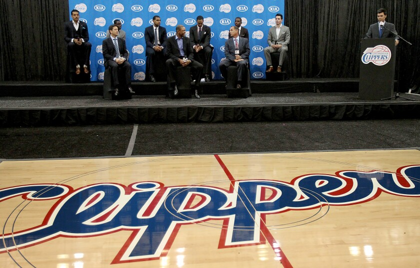 Clippers executives, head coach Doc Rivers, front center, and players take the stage during a news conference at the team's practice facility in Los Angeles.