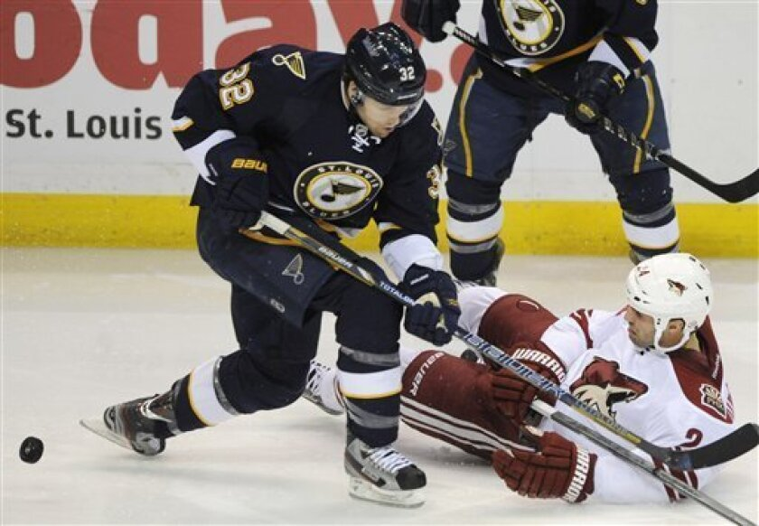 St. Louis Blues' Chris Porter (32) collides with Phoenix Coyotes' Kyle Chipchura (24) in the second period of an NHL hockey game on Thursday, March 14, 2013, in St. Louis. (AP Photo/Bill Boyce)