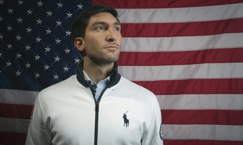 FILE - In this Sept. 30, 2013, file photo, Olympic figure skating champion Evan Lysacek poses for a portrait at the 2013 Team USA Media Summit, in Park City, Utah. Lysacek,the reigning Olympic figure skating champion, announced Tuesday, Dec. 10, 2013 that a torn labrum in his left hip will keep him from competing in the winter Olympics in Sochi. (AP Photo/Carlo Allegri, File)