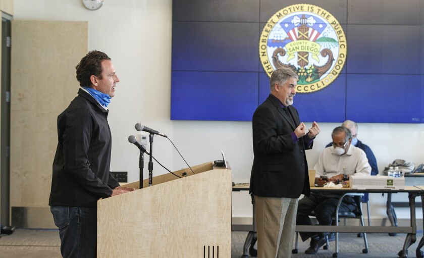 County supervisor Nathan Fletcher (left) speaks during the daily press briefing in April.
