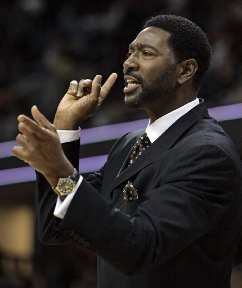 In this Oct. 7, 2008, file photo, Toronto Raptors coach Sam Mitchell gives instructions to his players during the second quarter of a preseason NBA basketball game against the Cleveland Cavaliers in Cleveland. The Raptors fired Mitchell on Wednesday, Dec. 3, 2008. (AP Photo/Tony Dejak, File)
