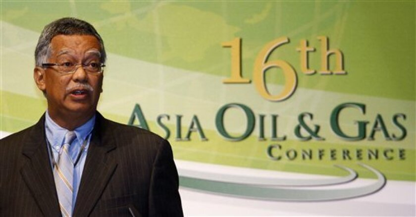 Petronas Chief Executive Shamsul Azhar Abbas speaks during the 16th Asia Oil and Gas Conference in Kuala Lumpur, Malaysia, Monday, June 6, 2011. Shamsul says global crude prices were overpriced and should ideally fall within the range of $75 to $80 a barrel. (AP Photo/Lai Seng Sin)
