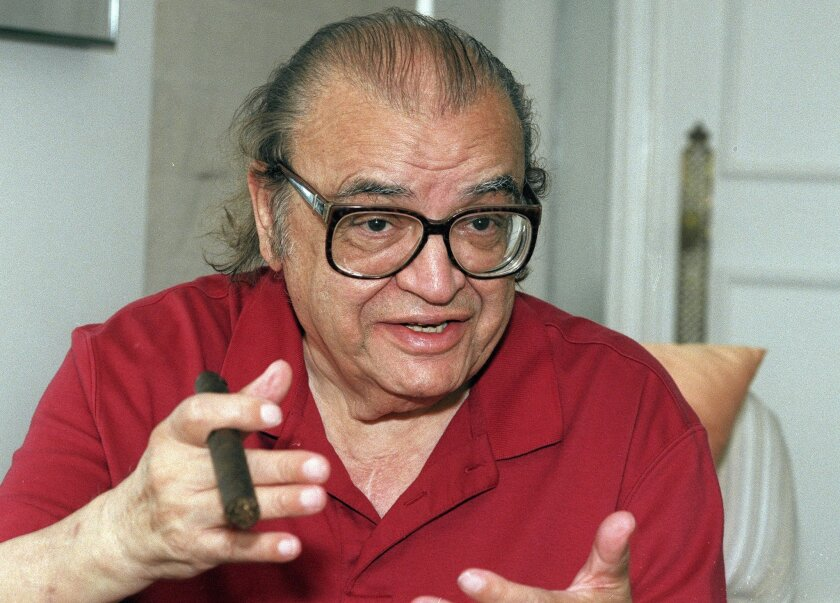 """FILE - In this July 25, 1996 file photo, author Mario Puzo talks during an interview in New York. A large collection Puzo's papers will be auctioned by Boston-based RR Auction on Feb. 18, 2016. The collection covers Puzo's entire career, but is highlighted by thousands of pages of """"The Godfather"""" n"""