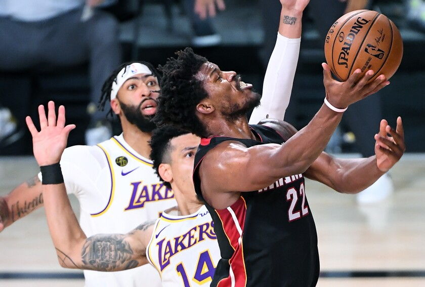 Miami's Jimmy Butler scores on a layup against Lakers guard Danny Green during the fourth quarter of Game 3 on Sunday.