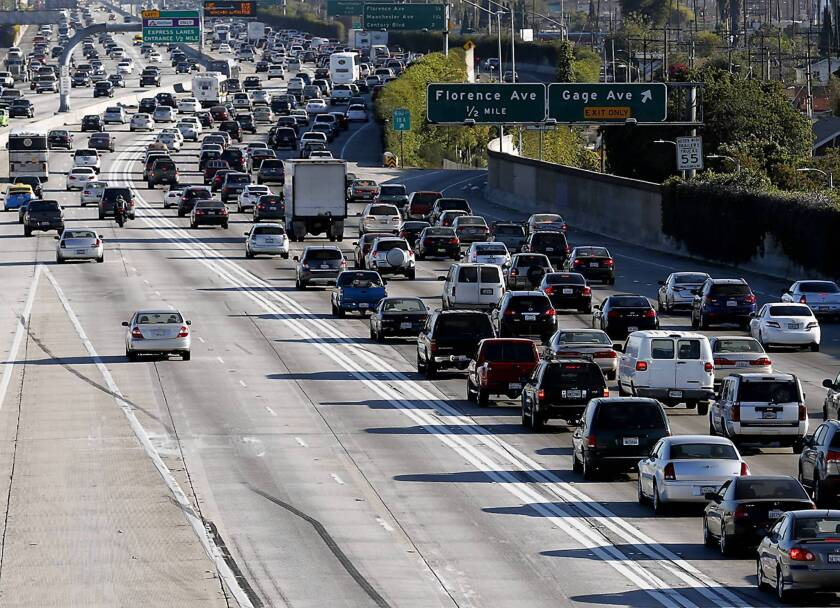 Traffic moves quickly in the 110 toll and carpool lanes as bumper-to-bumper congestion slows down regular traffic.