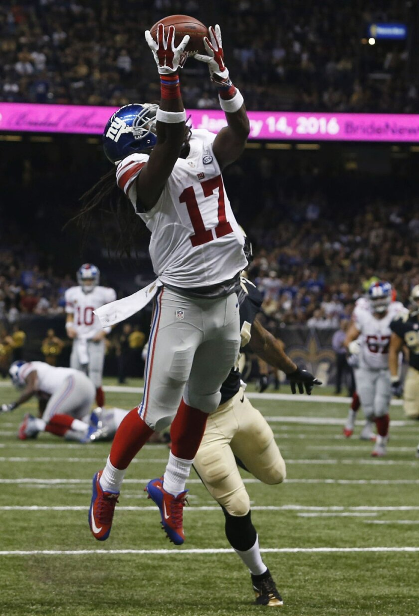 New York Giants wide receiver Dwayne Harris (17) pulls in a touchdown reception in the second half of an NFL football game against the New Orleans Saints in New Orleans, Sunday, Nov. 1, 2015. (AP Photo/Jonathan Bachman)