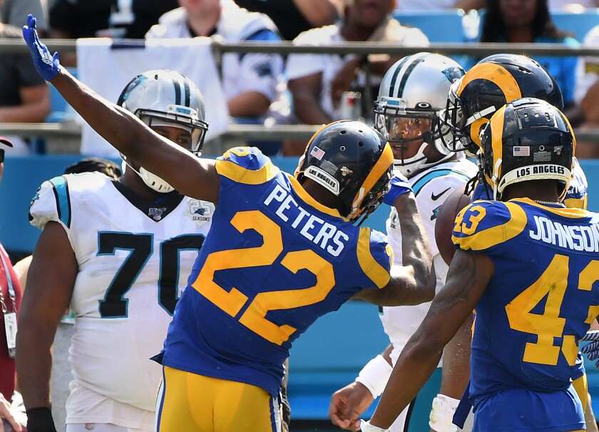 Rams cornerback Marcus Peters taunts Panthers quarterback Cam Newton after an interception by teammate Cory Littleton during the fourth quarter.