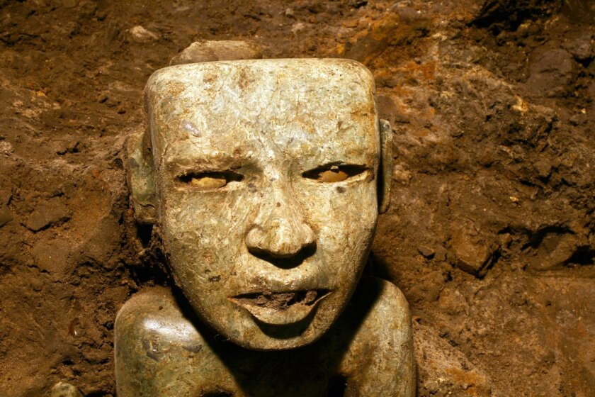 This Aug. 6, 2014 photo released by Mexico's National Institute of Anthropology and History (INAH) shows a sculpture unearthed at the Teotihuacan archeological site in Mexico.  Mexican archaeologists have concluded a yearslong exploration of a tunnel sealed nearly 2,000 years ago at the ancient cit