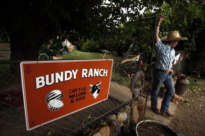Last year, Arden Bundy, then 15, takes a break from his duties at the front gate of his family's home and ranch in Bunkerville, Nev.