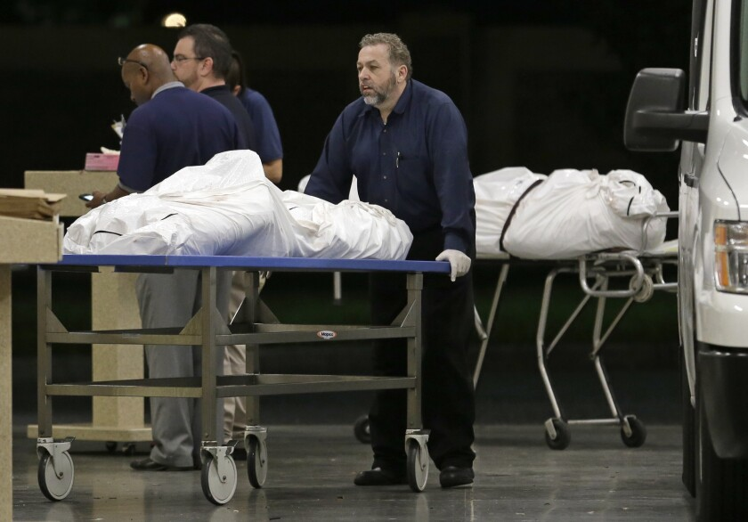 The bodies of two massacre victims arrive at the medical examiner's office in Orlando, Fla., on June 12, 2016.