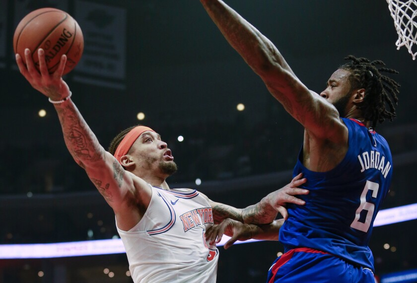 New York Knicks forward Michael Beasley, left, goes to the basket while defended by Los Angeles Clippers center DeAndre Jordan during the first half of an NBA basketball game in Los Angeles. In a deal announced Monday, July 23, 2018, the Los Angeles Lakers have signed Beasley to a one-year contract, adding the veteran forward to their revamped core around LeBron James.