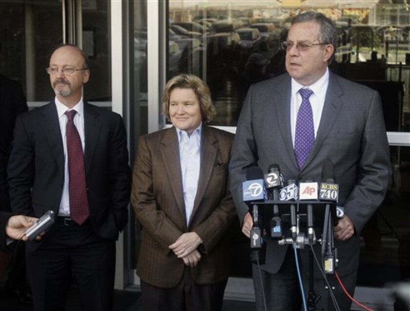 Ted Cassman, Cris Arguedas, and Allen Ruby, from left, attorneys for Barry Bonds, talk to to reporters outside the federal courthouse after the first day of Bonds' perjury trial in San Francisco, Monday, March 21, 2011. (AP Photo/Jeff Chiu)