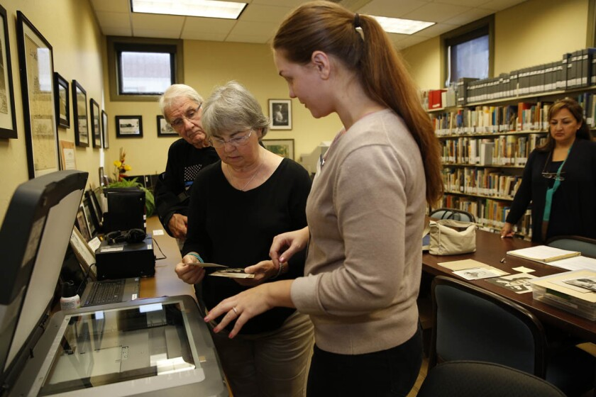 2715191_sd_me_test_library_NL San Diego, CA May 4, 2017 Library assistant Dana Sneberger gives Debbie Hill-Williams (center) and her husband, Bob Williams (behind her) hands on instruction during their visit the Memory Lab at the La Jolla/Riford Branch Library for a Test Driving San Diego column on offbeat programs and services offered by the city's branch libraries. At the Memory Lab, patrons can use software to convert their VHS tapes, cassette tapes, floppy discs, slides and photos to a digital format. Helping them are Dana Sneberger (left), a library assistant and Mojgan Dadjou (right), a library volunteer. © 2017 Nancee E. Lewis / Nancee Lewis Photography. No other reproduction allow with out consent of licensor. Permission for advertising reproduction required.