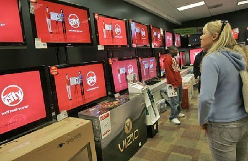 Televisions were offered at a Circuit City store in San Francisco in November. The consumer electronics retailer is going out of business. (Jeff Chiu / Associated Press)