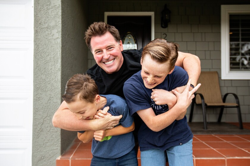 Bob Waeger, 41, and his sons, Jack, 11, and Cooper, 8, in the backyard of their Long Beach home.