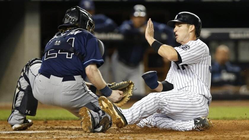 New York Yankees' Stephen Drew, right, is tagged out at the plate by Tampa Bay Rays catcher Ryan Hanigan (24) during the fifth inning of a baseball game at Yankee Stadium in New York, Tuesday, Sept. 9, 2014. Yankees manager Joe Girardi requested a video review of the play, but the ruling on the field was upheld. (AP Photo/Kathy Willens)