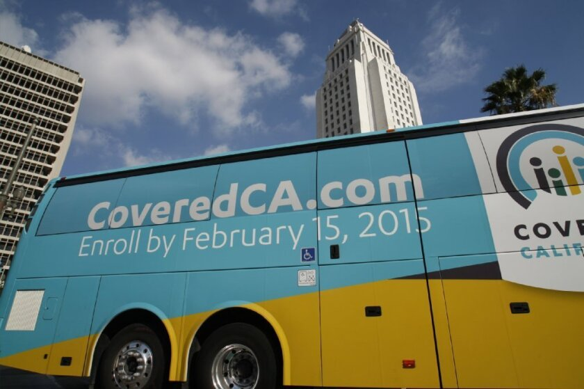 In a new poll, 39% of Californians said the state insurance exchange isn't working well, or not at all. Above, a Covered California bus came to downtown Los Angeles Nov. 14.