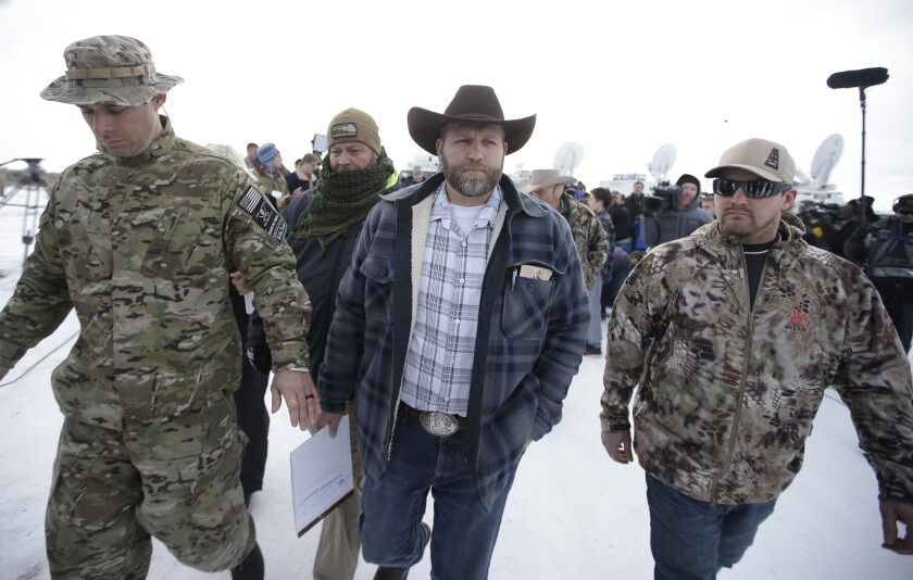 Ammon Bundy walks off after speaking with reporters