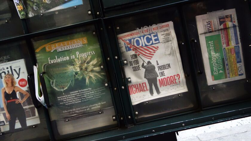 The Village Voice is on sale at a newsstand on 42nd Street in New York on Aug. 22. It has since gone out of business.