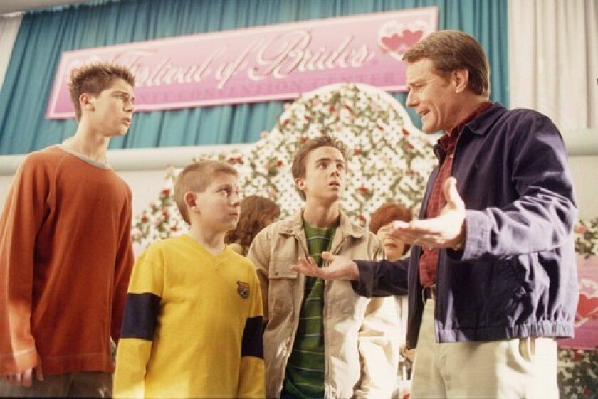 """Justin Berfield, from left, Erik Per Sullivan, Frankie Muniz and Bryan Cranston at a bridal expo in an episode of """"Malcolm in the Middle."""""""
