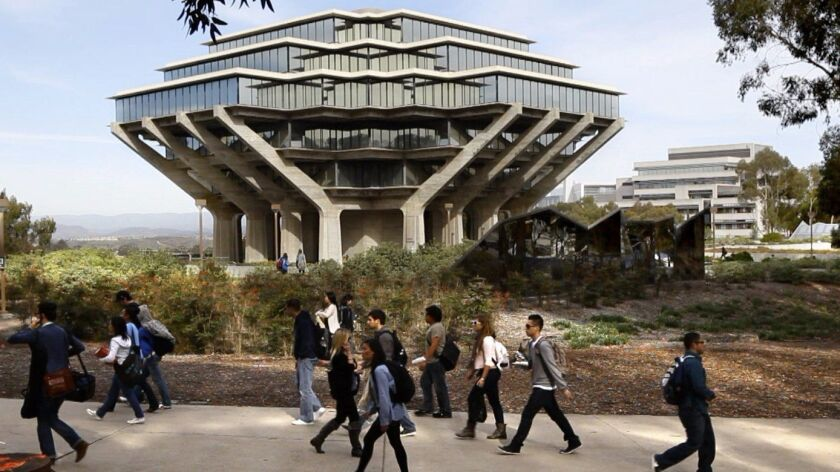 Students walk past UC San Diego's Geisel Library, which averages about 6,000 visitors per day.