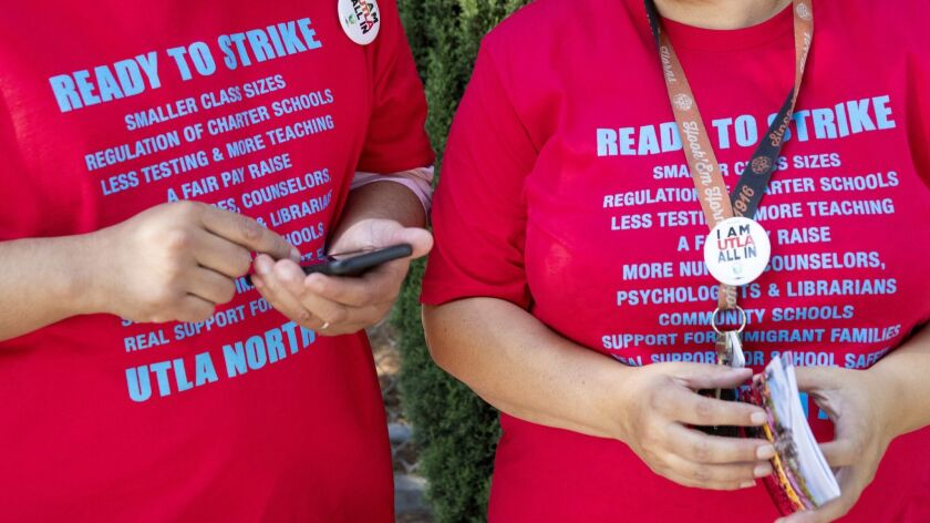 LAUSD teachers gather to talk about whether they will allow their union's leadership to call a strike on Aug. 23.