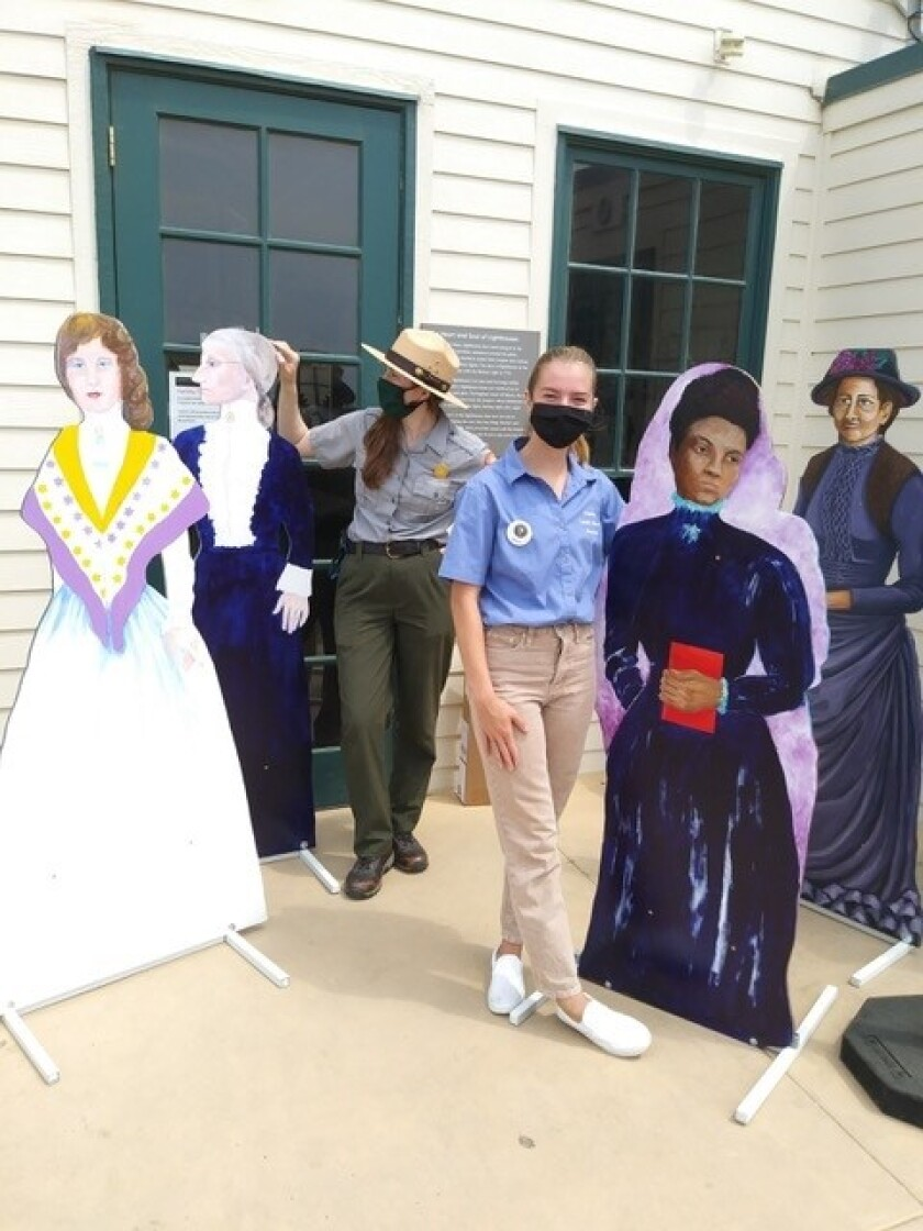 Sita Antel poses with a cutout prior to the 19th Amendment Centennial event. Her mentor Julieanne Fontana is behind her.