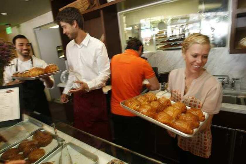 The croissants and other pastries at Maison Giraud are as good, if not better, than what you'd get in France itself. Pastry chef Noubar Yessayan, left, assisted here by Nick Malinowski, Florent Baudouin and Breanne Fuller, has adoring fans in the Palisades.