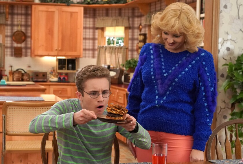 """Sean Giambrone and Wendi McLendon-Covey in """"The Goldbergs"""" on ABC."""