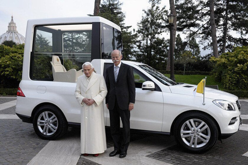 Dieter Zetsche, head of Mercedes-Benz Cars, stands with Pope Benedict XVI in front of the new Popemobile.
