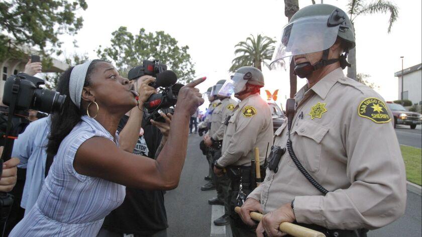 NATIONAL CITY, July 24, 2018 | Rashida Hameed yells at a San Diego Sheriff's deputy while he and ot