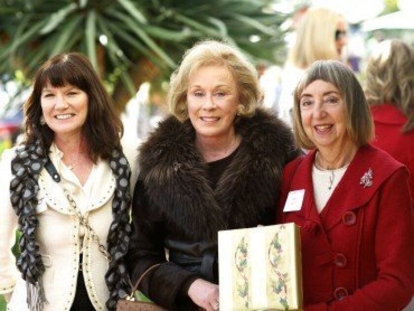 Theresa O'Connor, Ulla Updegraff and Erika Horn enjoy themselves at last year's Country Friends Holiday Tea. Photo by Jon Clark