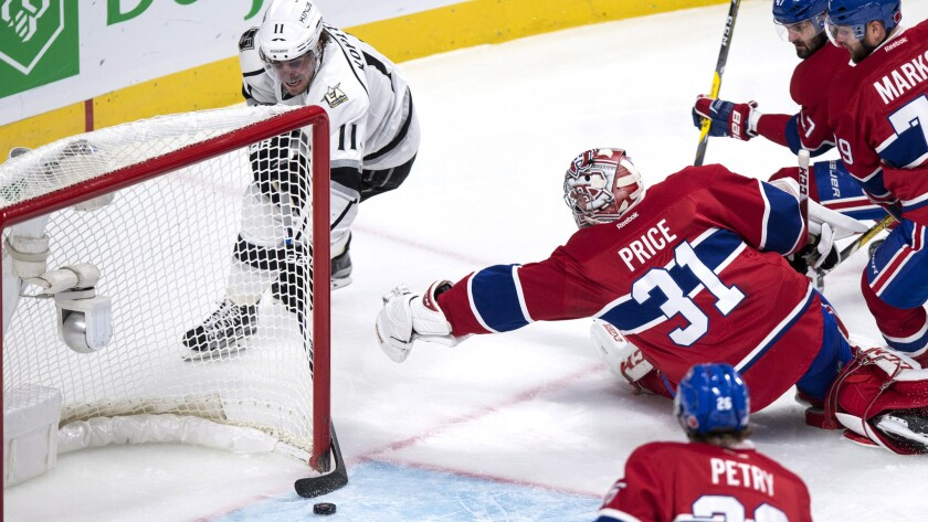 Kings center Anze Kopitar (11) seems to have an easy goal, but he can't put the puck in the net against Canadiens goalie Carey Price during the second period Thursday night.