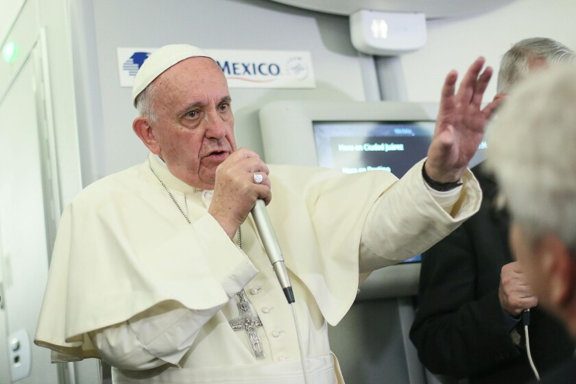 Pope Francis speaks to journalists aboard the flight from Mexico to Italy on Thursday.