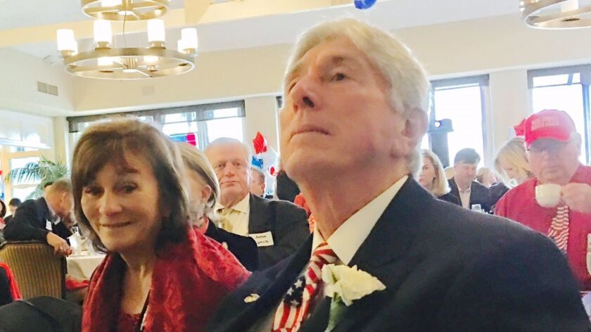 The non-elephant in the room? That would be trial attorney Vincent Bartolotta and his wife, Judy, both Democrats observing Trump's televised swearing-in at a predominantly GOP event.