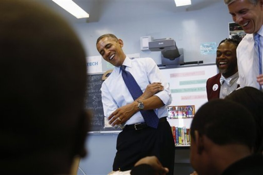President Barack Obama, sharing a laugh with Education Secretary Arne Duncan, right, as he visits a classroom in New York in 2013, is pushing to reduce the number of test students must take.