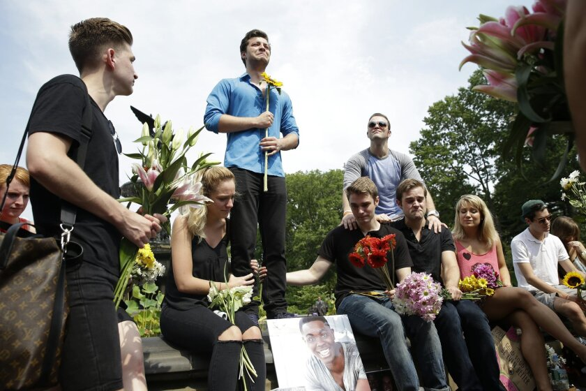 """Brandyn Day, center, talks about his best friend during a memorial gathering for Kyle Jean-Baptiste, Monday, Aug. 31, 2015, at Bethesda fountain in New York's Central Park. Baptiste, the first African-American and youngest person to ever play the role of Jean Valjean in """"Les Miserables"""" on Broadway, died after falling from a fire escape over the weekend, according to a show spokesman. He was 21. (AP Photo/Mary Altaffer)"""