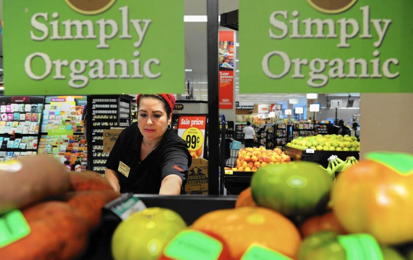 Southern California's $44 billion in annual grocery sales makes it the largest U.S. grocery market by far. Above, produce clerk Veronica Padilla stocks apples at the Ralphs grocery store in downtown Los Angeles.